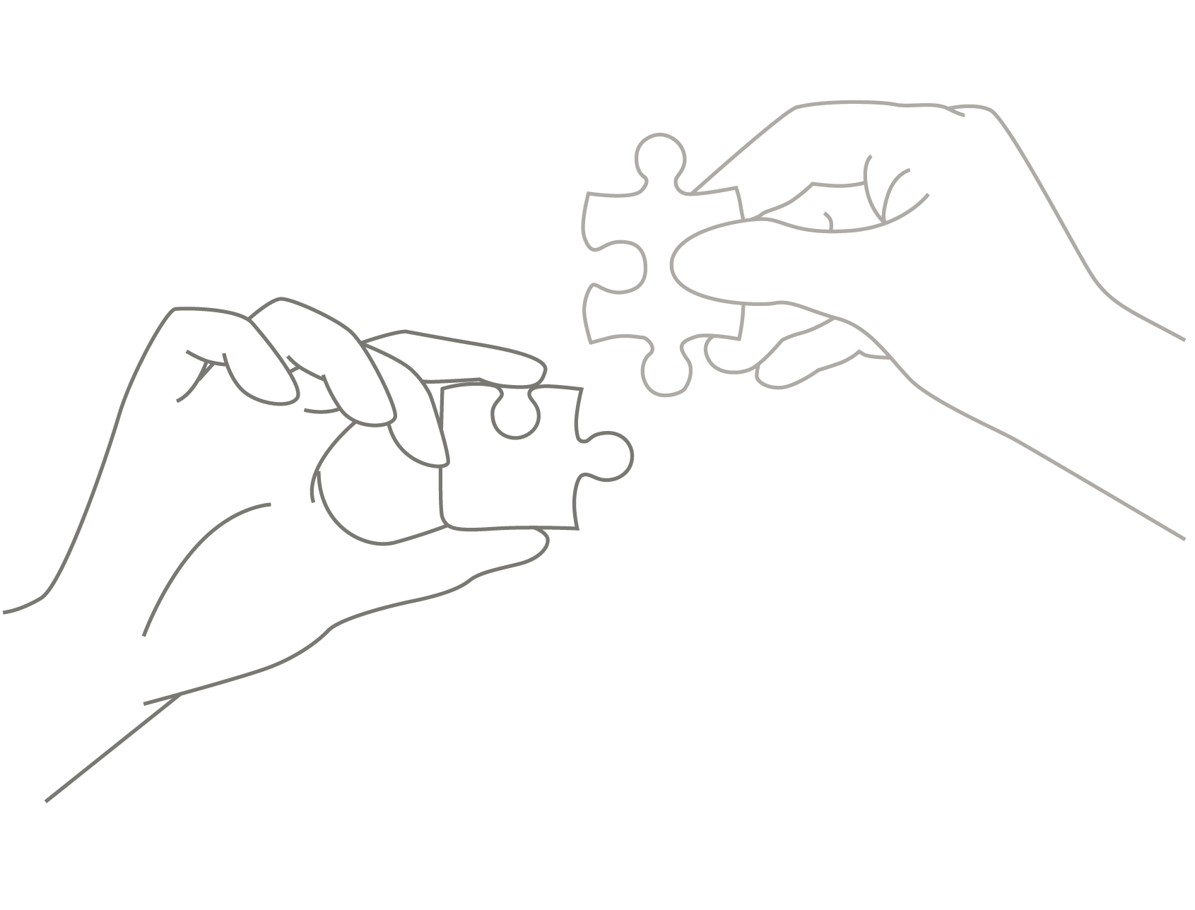 Two hands coming together each holding a puzzle piece that connects to the other